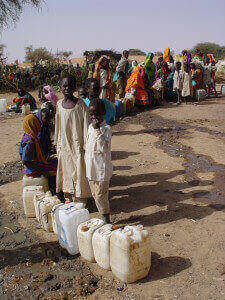 Lines for water---when it is available---can seem interminable; often there is simply not enough water for all in concentrated camp areas.