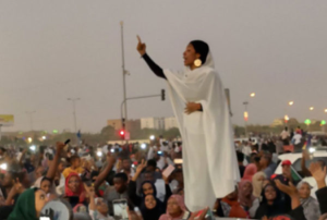Iconic photo of Alaa Salah, a Sudanese woman protestor leading the uprising against Former President Al-Bashir
